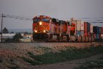 BNSF 6624 Leads a Double Stack at 19:18 pm thru West Grants, NM with BNSF 7016 as Her #3 C4 Just Out of GE Erie, PA :)))